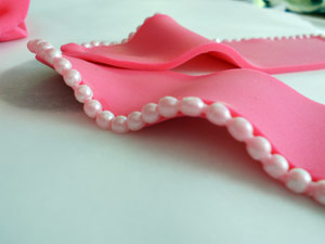 Adding pearl/bead trim to the bow